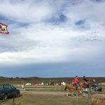 Horses and riders at Sacred Stone camp